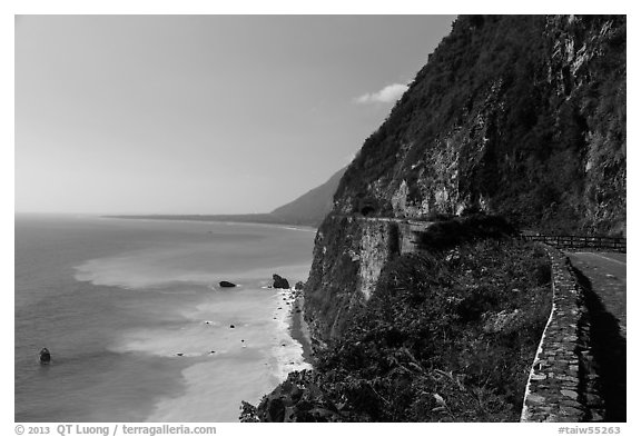 Road atop steep see cliffs overlooking ocean. Taroko National Park, Taiwan (black and white)