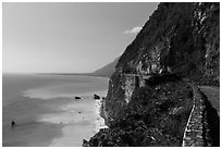 Road atop steep see cliffs overlooking ocean. Taroko National Park, Taiwan ( black and white)