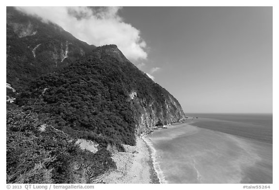 Lush mountains drop into azure ocean. Taroko National Park, Taiwan (black and white)