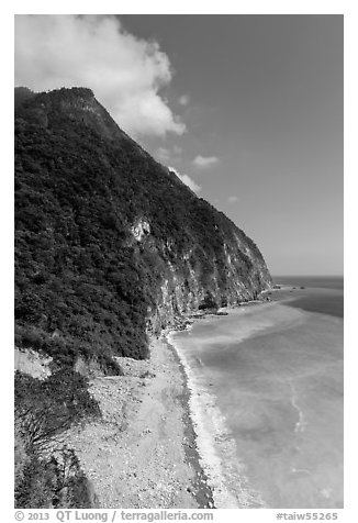 Lush high hills drop into turquoise ocean. Taroko National Park, Taiwan (black and white)