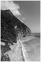 Lush high hills drop into turquoise ocean. Taroko National Park, Taiwan ( black and white)