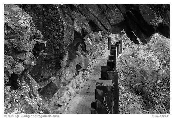Narrow trail under rock overhang, Taroko Gorge. Taroko National Park, Taiwan (black and white)