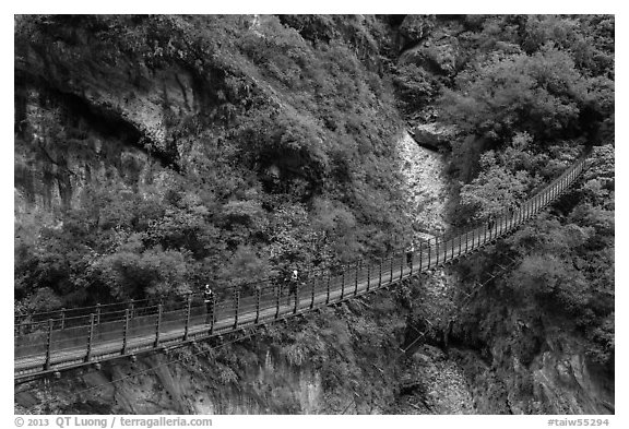 Suspension bridge with hikers. Taroko National Park, Taiwan (black and white)