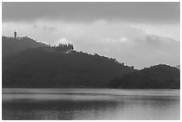 Shabalan Mountain ridge in mist with Syuanzang Temple and Tsen Pagoda. Sun Moon Lake, Taiwan ( black and white)