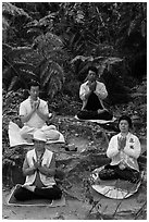 Members of religious sect in meditation. Sun Moon Lake, Taiwan ( black and white)