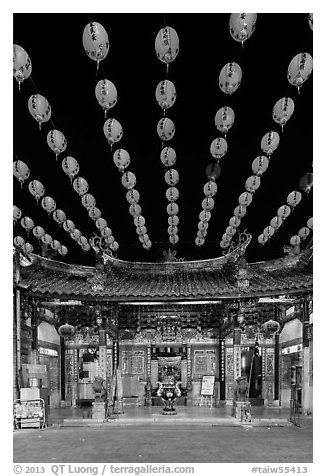 Array of red paper lanterns and temple at night. Lukang, Taiwan (black and white)