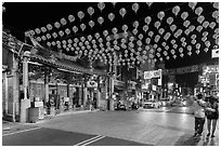 Street at night with temple and red paper lanterns. Lukang, Taiwan (black and white)