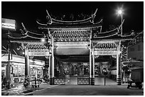 Temple gate and convenience store at night, Matzu Temple. Lukang, Taiwan (black and white)