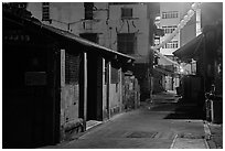 Old houses and lanterns on Chinseng Lane at night. Lukang, Taiwan (black and white)