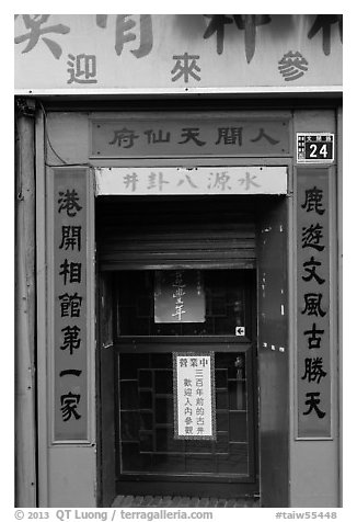 Purple doorway with red and yellow banners. Lukang, Taiwan (black and white)