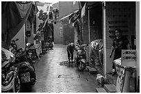 Woman cleaning in alley. Lukang, Taiwan ( black and white)