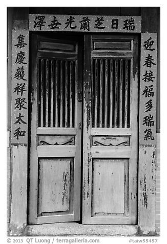 Wooden door with chinese script on red paper. Lukang, Taiwan (black and white)