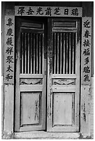 Wooden door with chinese script on red paper. Lukang, Taiwan ( black and white)