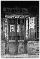 Door with weathered wood and inscriptions. Lukang, Taiwan ( black and white)