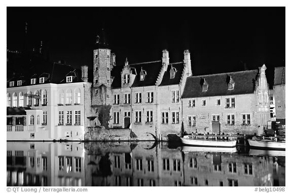 Houses reflected in canal, Rozenhoedkaai, night. Bruges, Belgium (black and white)