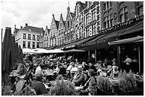 People in restaurants on the Markt. Bruges, Belgium (black and white)
