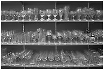 Large variety of glasses used to drink specific beers. Bruges, Belgium (black and white)