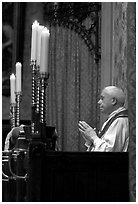 Priest in the the Basilica of Holy Blood. Bruges, Belgium ( black and white)