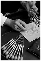 Hands of a lacemaker at work. Bruges, Belgium (black and white)