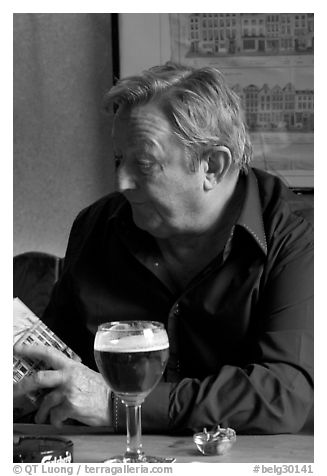 Man with book and beer. Brussels, Belgium (black and white)