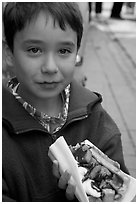 Boy eating a Belgian waffle. Brussels, Belgium ( black and white)