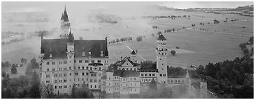 Neuschwanstein castle and fog. Bavaria, Germany (Panoramic black and white)