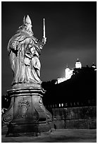 Saint Killian statue on  Alte Mainbrucke (bridge) and Festung Marienberg (citadel) at night. Wurzburg, Bavaria, Germany (black and white)