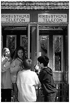 Swedish kids in a phone booth. Stockholm, Sweden (black and white)
