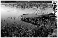 Red boat on a lakeshore. Central Sweden (black and white)