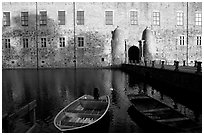 Boat and moat of Vadstena slott. Gotaland, Sweden (black and white)