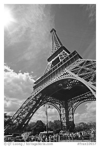 Eiffel tower and sun with crowds at base. Paris, France (black and white)