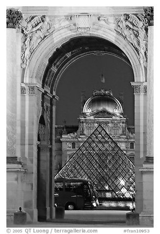 Louvre, pyramid, and bus seen through the Carousel Arch at night. Paris, France (black and white)