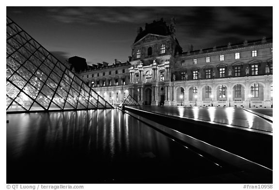 Basin, Pyramid, and Louvre at dusk. Paris, France (black and white)