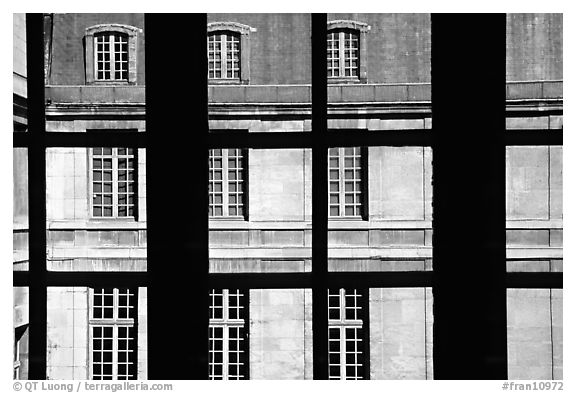 Versailles Palace walls seen from a window. France (black and white)