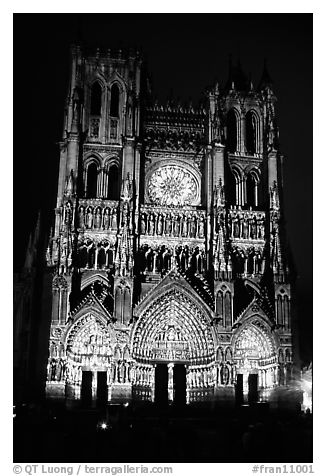 Cathedral facade laser-illuminated at night to recreate original colors, Amiens. France (black and white)