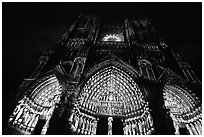 Looking up cathedral with doors laser-illuminated to recreate original colors, Amiens. France ( black and white)