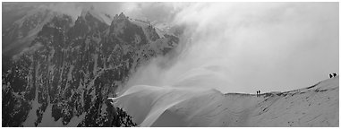 Ridge with alpinists and high peaks. France (Panoramic black and white)