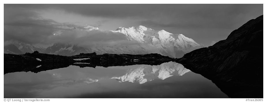 Mountain scenery with high peak reflected at sunset, Mont-Blanc. France (black and white)