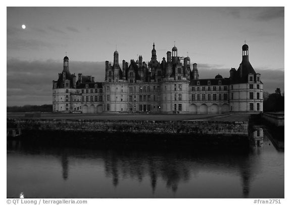 Chambord chateau at dusk with moonrise. Loire Valley, France