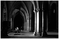 Worshiper inside the Saint-Etienne Cathedral. Bourges, Berry, France (black and white)