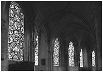 Aisle with tained glass windows, Saint-Etienne Cathedral. Bourges, Berry, France (black and white)