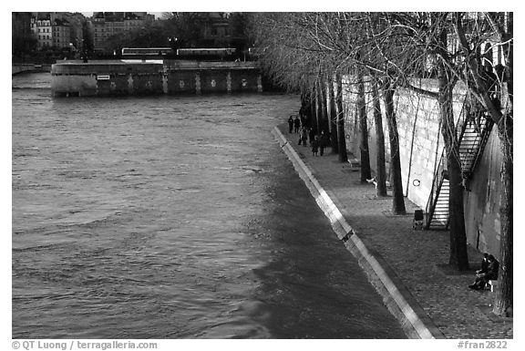 Walking on the banks of the Seine on the Saint-Louis island. Paris, France (black and white)