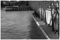 Walking on the banks of the Seine on the Saint-Louis island. Paris, France ( black and white)