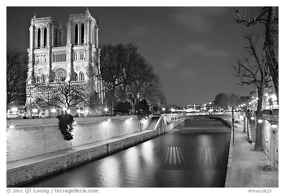 Facade of Notre Dame and Seine river at night. Paris, France (black and white)