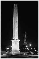 Luxor obelisk of the Concorde plaza and Eiffel Tower at night. Paris, France (black and white)