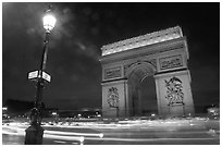 Arc de Triomphe illuminated at night. Paris, France (black and white)