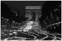 Arc de Triomphe and Champs Elysees at night. Paris, France (black and white)