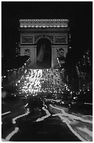 Arc de Triomphe and lights of cars on Champs Elysees. Paris, France (black and white)