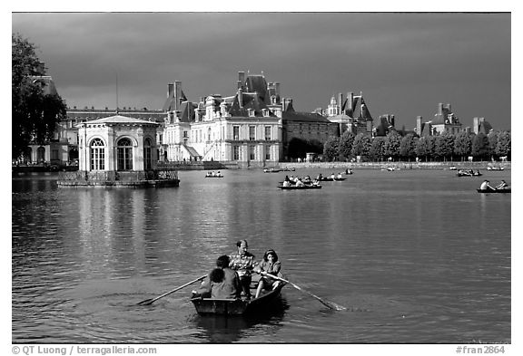 Rowers and Fontainebleau palace. France (black and white)