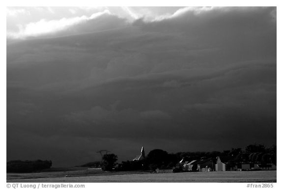 Stormy skies and village. France (black and white)